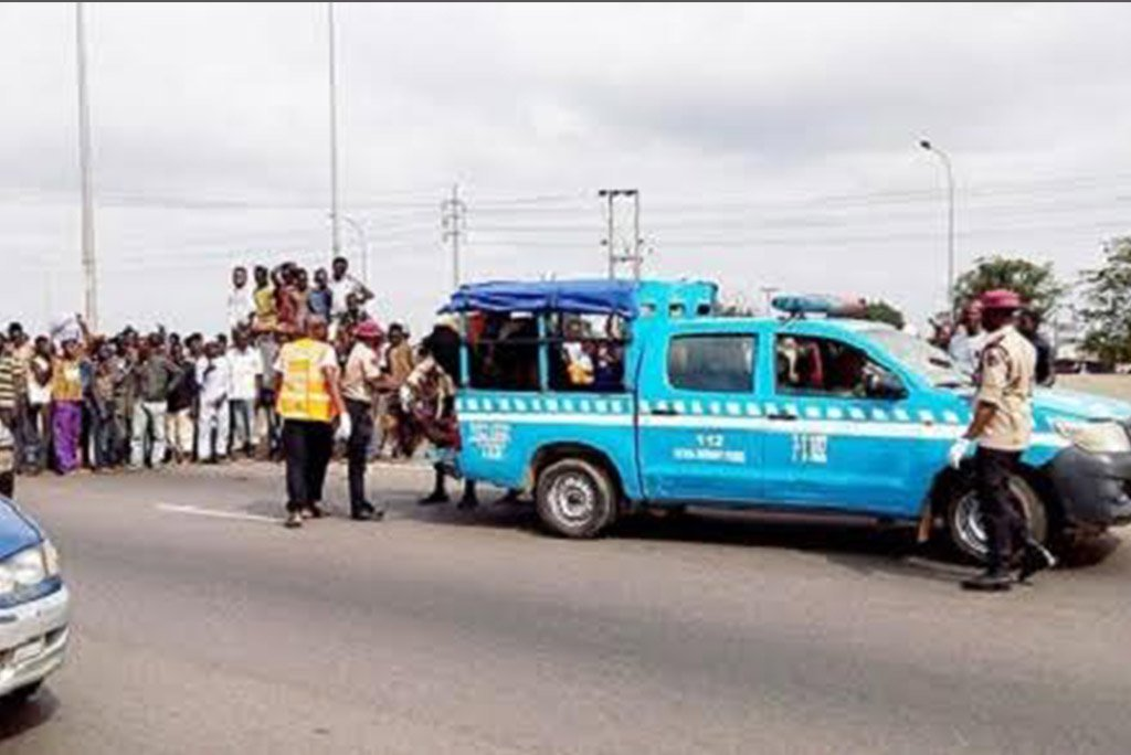 frsc-official-throws-stone