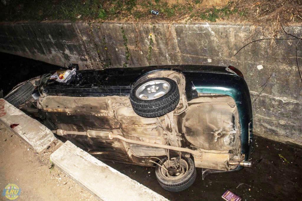 car-falls-into-gutter