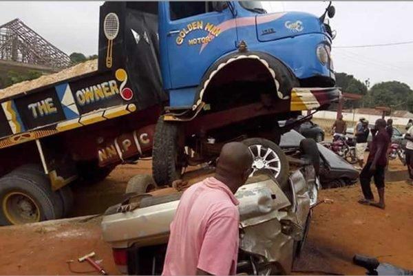 truck crushes car