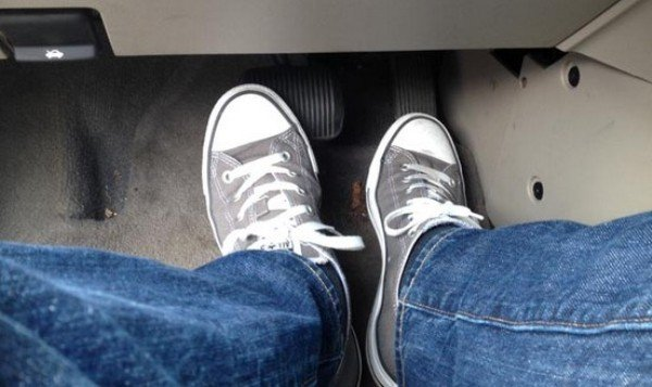 driver with both feets on pedal