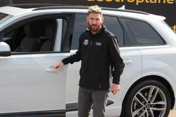 lionel messi and his Audi Q7