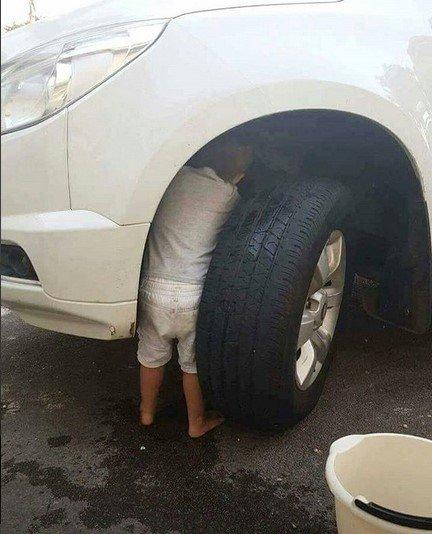 kid under car