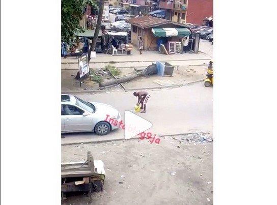 man washing on road