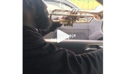 driver using trumoet as horn