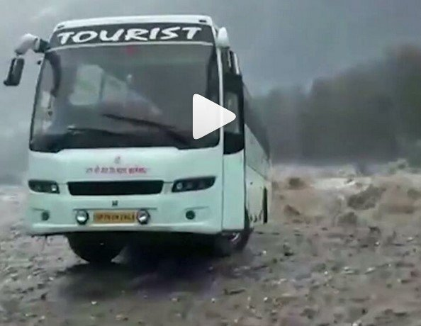 luxurious bus swept away by flood