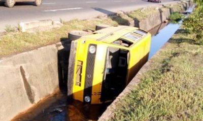 danfo tumbles into gutter