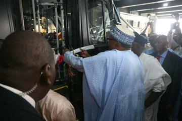 buhari commissions buses lagos