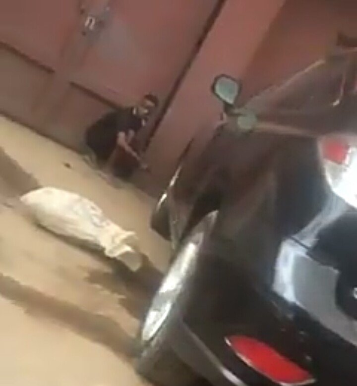Man Chaining Car To Gate