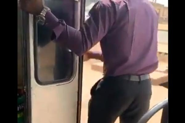 Corporate Bus Conductor Seen In Abuja