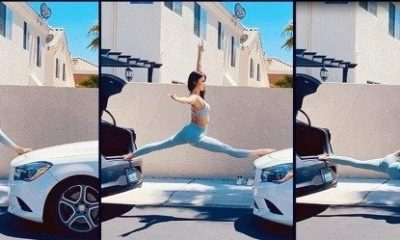 one-static-and-reversing-car-polish-woman-performs-scary-but-amazing-split-on-two-cars