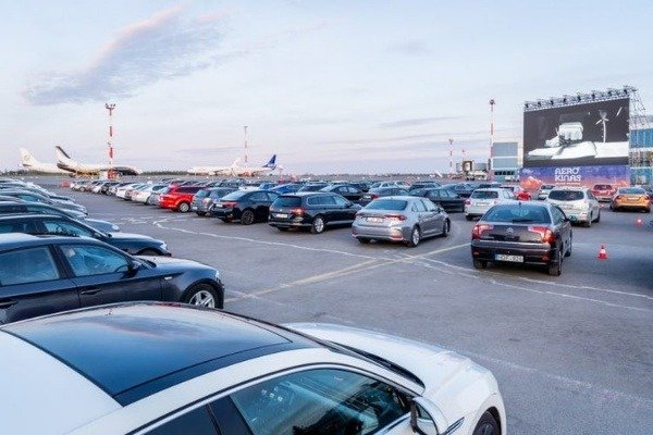 dozens-of-cars-showed-up-to-watch-movie-as-lithuania-turns-vilnius-airport-into-drive-in-cinema