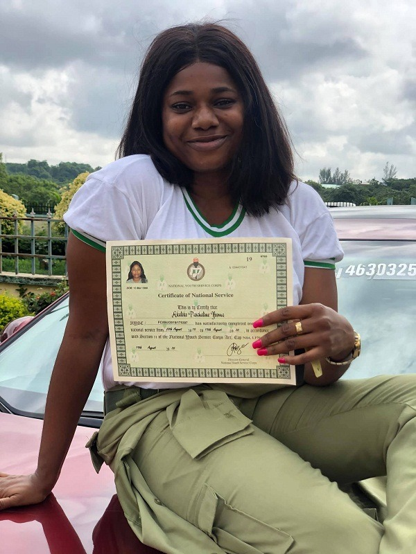 female corper posing with her SUV