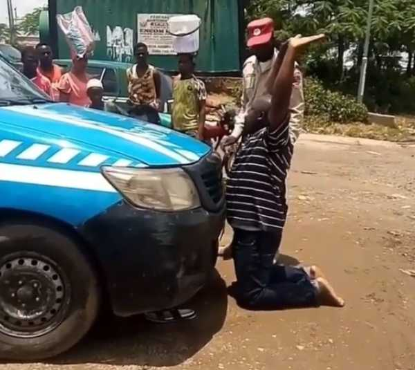 knock-me-down-man-kneels-in-front-of-frsc-van-seized-license