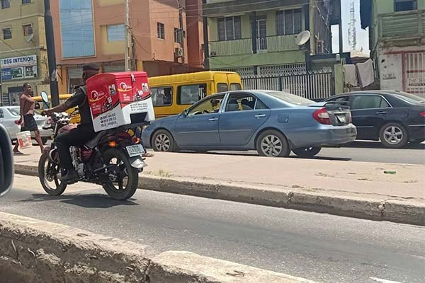 Police Officer Spotted Riding A Dispatch Bike In Lagos