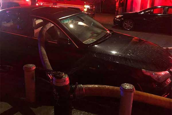 Firefighters Smash Windows Of A BMW Parked In Front Of Fire Hydrant