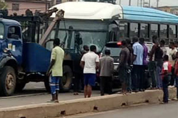 See How A BRT Crushed Two Lagosians To Death Between Iyana Ipaja And Ile Epo Road