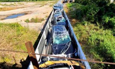 brand-new-cars-destroyed-after-ford-train-crashes-bridge