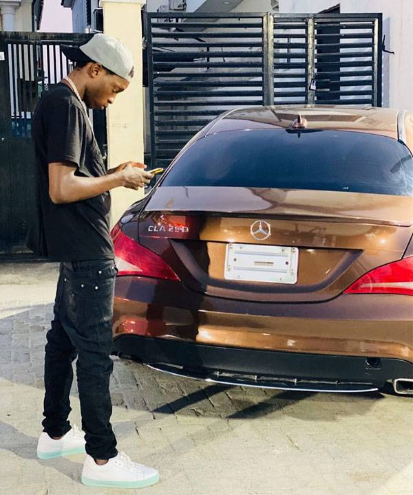 Naira Marley Buys A Mercedes-Benz CLA For His Younger Brother