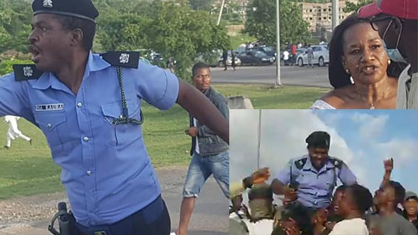 Policeman Carried On Shoulders Of Protesters For Saving A Woman From Being Harassed In Abuja