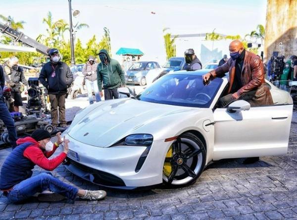 Dwayne Johnson Can't Fit In A Porsche Taycan - autojosh