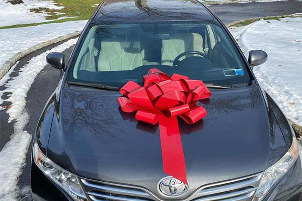 Popular Nigerian Actress, Sonia Ogiri Presents Mother Toyota Venza As Christmas Gift (PHOTOS)