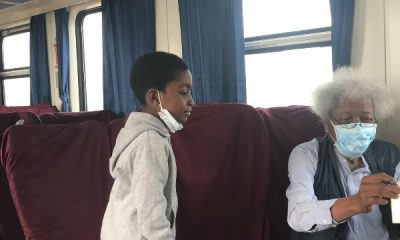 Professor Wole Soyinka Enjoys Lagos-Ibadan Train Ride, Signs Autograph For A Kid - autojosh