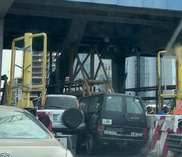 Two Cars Wedged Into One Another As They Battle To Pass Through Ticketing Line At Lekki Tollgate - autojosh