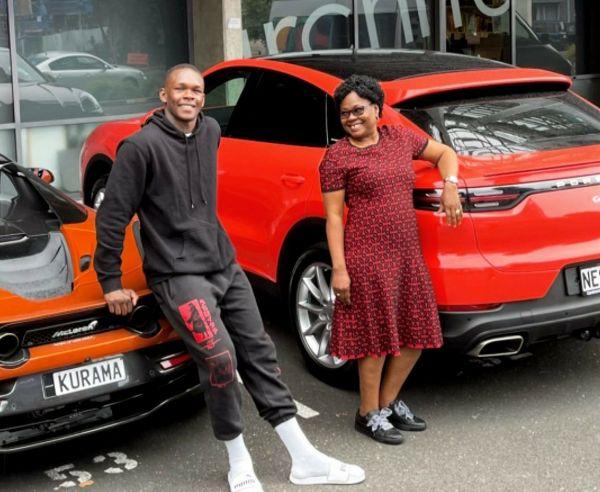 Martial Artist, Israel Adesanya, Gifts Mum A New Porsche SUV, Flaunts His McLaren 720s Spider - autojosh