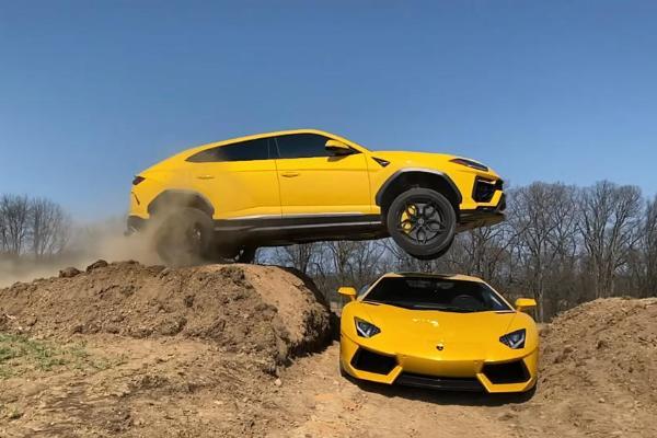 Watch YouTuber Jump His Lamborghini Urus Over His Wife's Lamborghini Aventador - autojosh
