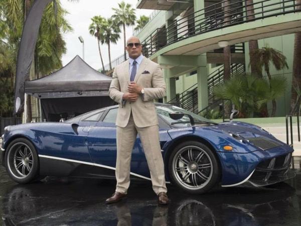 Dwayne 'The Rock' Johnson Can't Fit In A Porsche Taycan - autojosh
