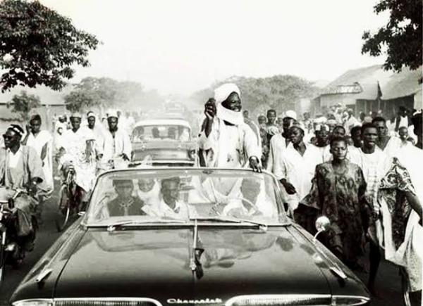 Throwback : Sir Ahmadu Bello On A Boat Cruise To Kainji Dam Site Before Construction Began In 1964 - autojosh