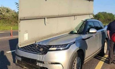 UK Driver Escapes Death After Crashing Range Rover Into Road Sign, Slicing Through Through The SUV - autojosh