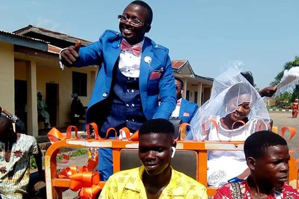 Ekiti OAP Shares Wedding Pictures, Rides In Tricycle Pick Up With Bride To Reception