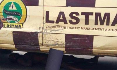 PHOTOS: Driver Resists Arrest, Lies Naked Under LASTMA Vehicle In Ikeja - autojosh