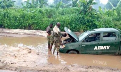 Nigerian Soldiers Struggles To Extract Toyota Hilux Pickup Truck Stuck In The Mud - autojosh