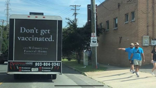 A Funeral Truck With Ad 'Don't Get Vaccinated' Urges People To Get Vaccinated - autojosh
